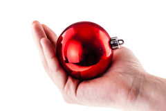 Holding a red xmas ball. A christmas ball isolated over a white background Royalty Free Stock Images