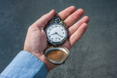 Holding retro pocket watch Royalty Free Stock Photography