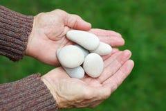 Holding round stones Stock Photo