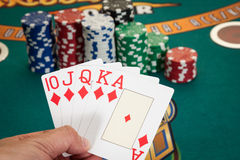 Holding royal flush cards Royalty Free Stock Photography