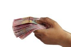 Holding 100000 Rupiah Stock Photo