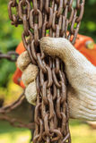 Holding rusty chain Stock Images