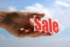Holding sale card Royalty Free Stock Photo
