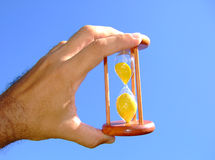 Holding a sand-glass Stock Image