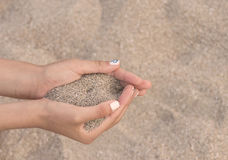 Holding sand Stock Images