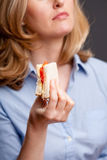Holding a sandwich Stock Images