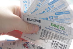 Holding saving coupons Royalty Free Stock Photo