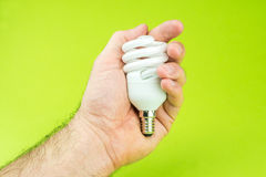 Holding the savings for energy in own hands Royalty Free Stock Images