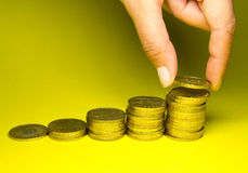 Holding savings of gold coins Royalty Free Stock Images