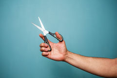 Holding scissors Royalty Free Stock Photo