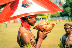 Holding seashell in Papua New Guinea Royalty Free Stock Images