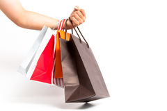 Holding shoping bags by hand. On white isolate stock photo