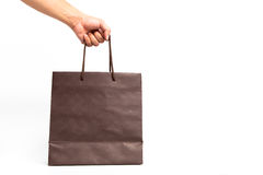 Holding shoping bags by hand. On white isolate stock image