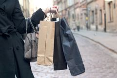 Holding shopping bags. A woman holding shopping bags stock images