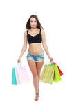 Holding shopping bags. Casual girl in black top and shorts holding shopping bags Stock Photos