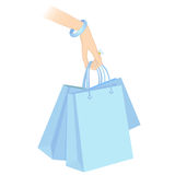 Holding shopping packages Royalty Free Stock Photos