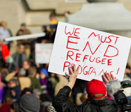 Holding a sign to stop refugees Royalty Free Stock Photography