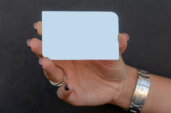 Holding a silver vip card_empty. Woman is holding a silver vip card Royalty Free Stock Photography