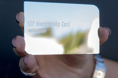 Holding a silver vip card. Woman is holding a silver vip card Stock Image