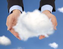 Holding a single cloud Stock Photos