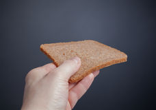 Holding a slice of bread Royalty Free Stock Photo