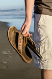 Holding slippers Royalty Free Stock Image
