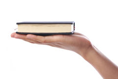 Holding Small Book Stock Image