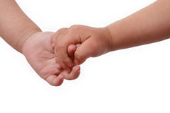 Holding small hands. Two children are holding small hands mutually stock image