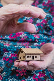 Holding a small house Stock Photos