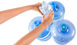 Holding Small And Large Mineral Water Container IV Royalty Free Stock Photos