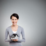 Holding small toy house in front of herself Stock Photography
