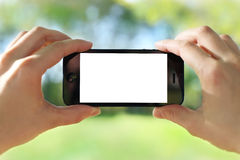 Holding smart phone Stock Photography