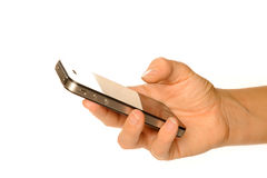 Holding smartphone. Holding business black smartphone Stock Photo