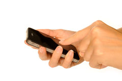 Holding smartphone. Holding business black smartphone Stock Images