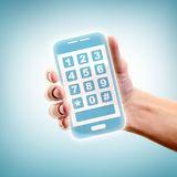 Holding smartphone Stock Photos