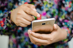 Holding smartphone. A female hand holding a smartphone Royalty Free Stock Photos