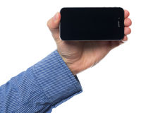 Holding smartphone Stock Photography