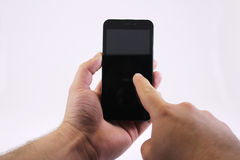 Holding a smartphone Stock Images