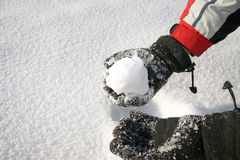 Holding the snowball Royalty Free Stock Photography