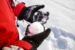 Holding the snowball Royalty Free Stock Images