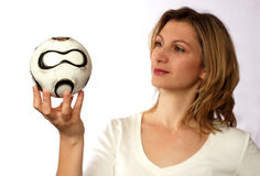 Holding soccer ball Royalty Free Stock Images