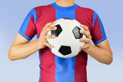 Holding soccer ball Royalty Free Stock Photography