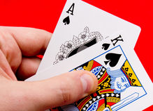 Holding spades Royalty Free Stock Photo