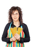 Holding a spaghetti uncooked Stock Photography