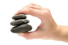 Holding Stacked Stones Stock Images