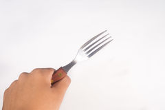 Holding Stainless Steel Fork on White Background Stock Image