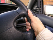 Holding a steering wheel Royalty Free Stock Photography