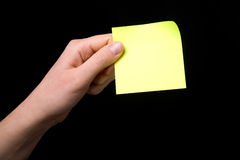 Holding a Sticky Note Stock Photo