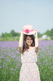 Holding a straw hat of the girl in flowers Royalty Free Stock Image