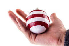 Holding a Striped christmas ball Royalty Free Stock Photos